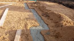 Beton im Fundamentgraben