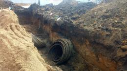 Grabenarbeiten: Graben abböschen